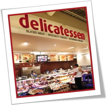 a delicatessen cheia de salame, salsicha, vinhos, queijos, guloseimas