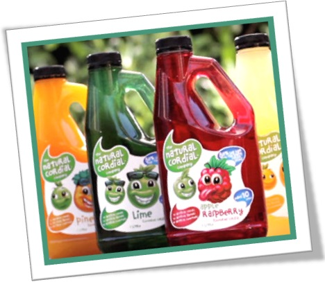 bottles of natural cordial raspberry pineapple lime orange