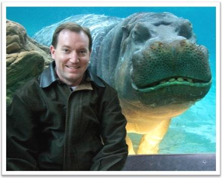 photobomb hipopotamo fotografia homem parque aquático mamíferos sorrissos
